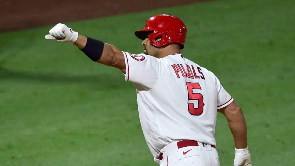 ANAHEIM, CA - SEPTEMBER 18: Albert Pujols #5 of the Los Angeles Angels crosses the plate after hitting career home run No. 661 passing Hall of Famer and San Francisco Giants legend Willie Mays and sole possession session of fifth place on baseballs all-time home run list in the fifth inning of the game against the Texas Rangers at Angel Stadium of Anaheim on September 18, 2020 in Anaheim, California. (Photo by Jayne Kamin-Oncea/Getty Images)