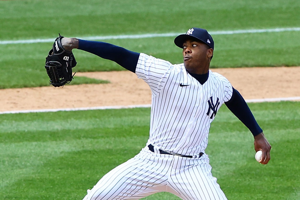 NEW YORK, NEW YORK - MAY 02: Aroldis Chapman #54 of the New York Yankees pitches in the ninth inning against the Detroit Tigers at Yankee Stadium on May 02, 2021 in New York City. (Photo by Mike Stobe/Getty Images)