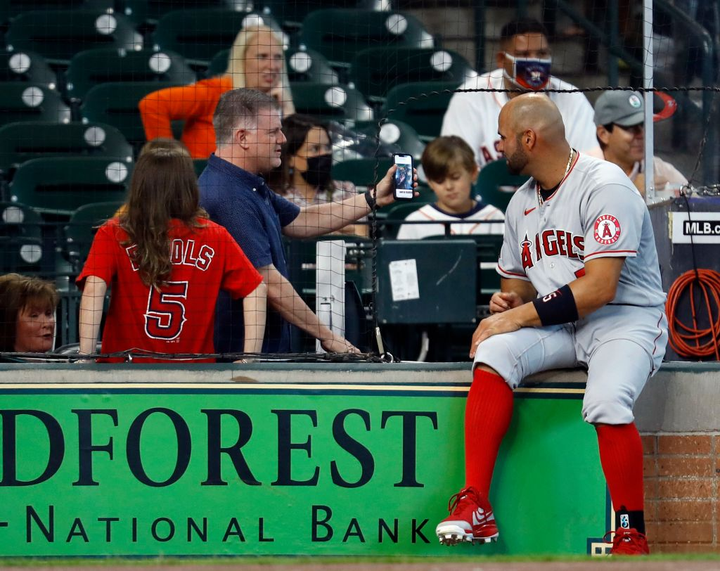 HOUSTON, TEXAS - APRIL 25: Albert Pujols #5 of the Los Angeles Angels talks fans prior to playing the Houston Astros at Minute Maid Park on April 25, 2021 in Houston, Texas. (Photo by Bob Levey/Getty Images)