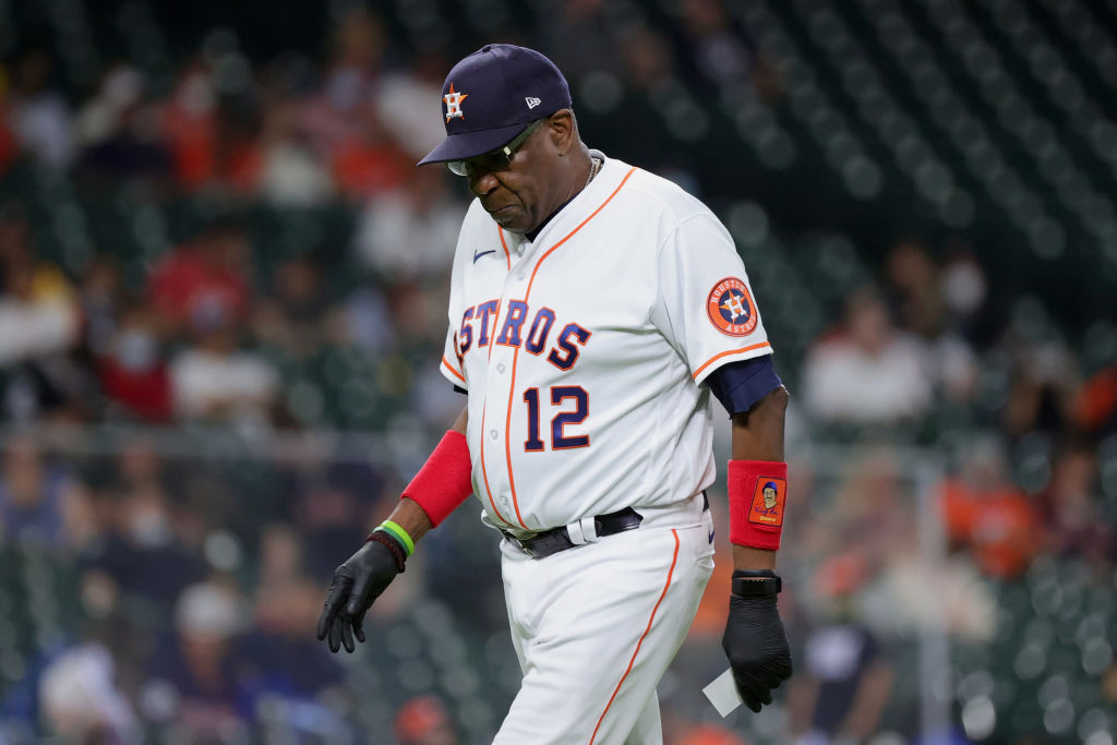 HOUSTON, TEXAS - MAY 10: Manager Dusty Baker Jr. #12 of the Houston Astros walks back from a mound visit during the eighth inning against the Los Angeles Angels at Minute Maid Park on May 10, 2021 in Houston, Texas. (Photo by Carmen Mandato/Getty Images)