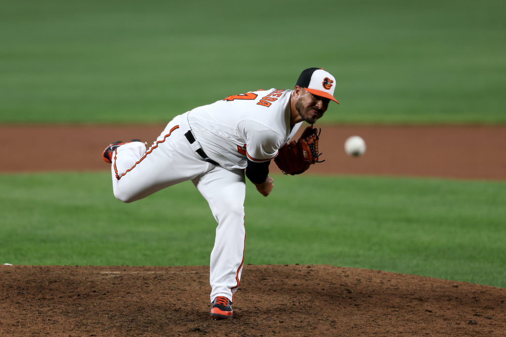 BALTIMORE, MARYLAND - SEPTEMBER 08: Manny Barreda #84 of the Baltimore Orioles makes his MLB debut pitching to a Kansas City Royals batter in the eighth inning at Oriole Park at Camden Yards on September 08, 2021 in Baltimore, Maryland. (Photo by Rob Carr/Getty Images)